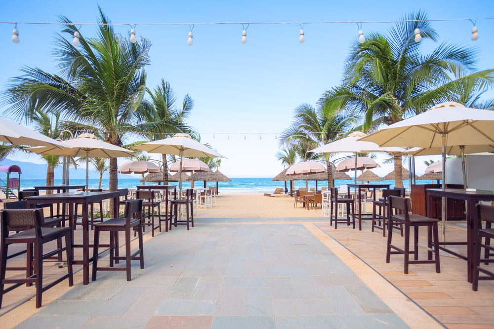 photo of empty cafe on the beach at tropical sea